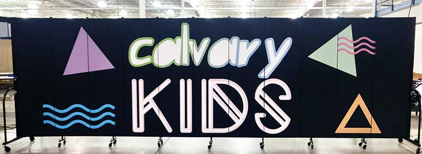 Calvary Kids logo printed on a black portable wall