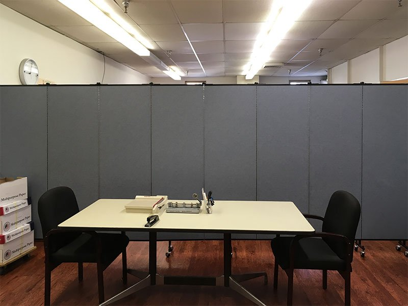 Room dividers across a room to create a workroom