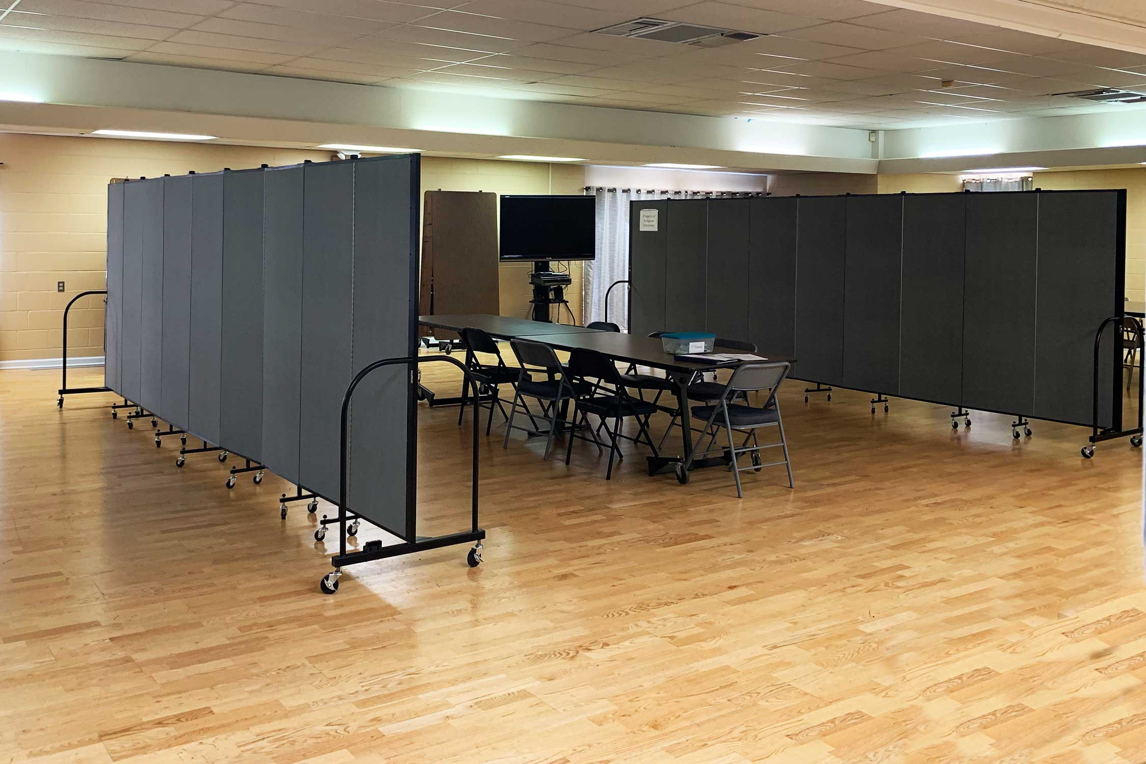 Two room dividers separate a large room into thirds