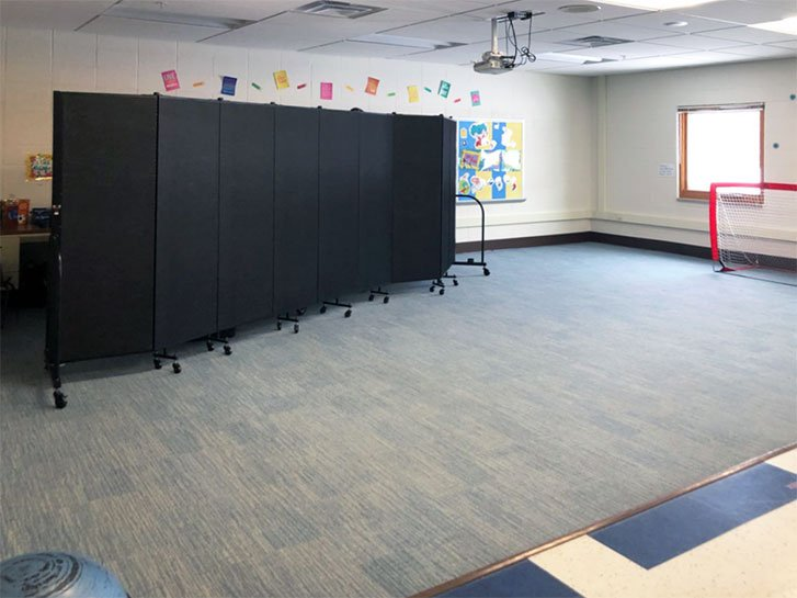 A room divider provides privacy in a therapy classroom