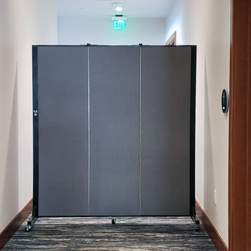 3-panel blue divider restricts access in a hallway