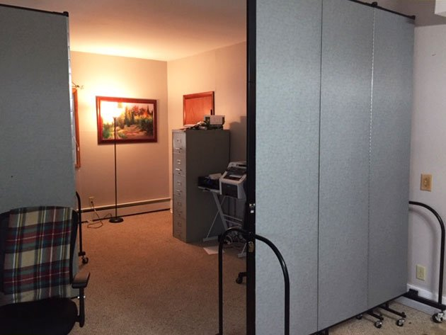 Two room dividers create a bedroom for a inhome care center