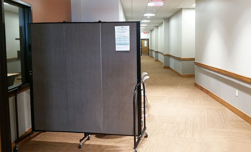 Privacy wall in a hallway for tax preparation
