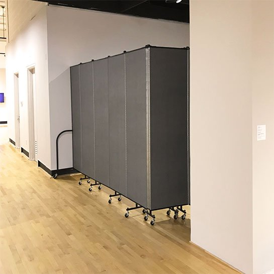 Portable walls shield access to a newly created art exhibit
