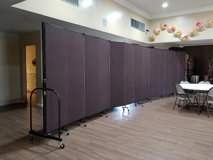 Room divider creates a hallway in a fellowship hall