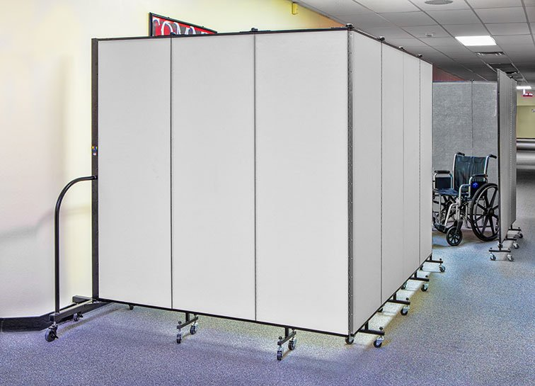 Two dividers set up in a hallway to provide medical space for patients
