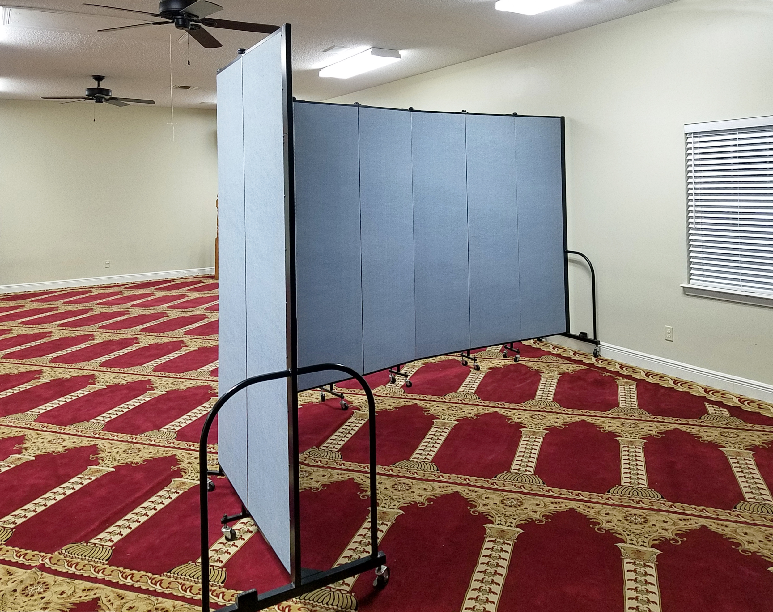 Ample room is provided behind a portable divider