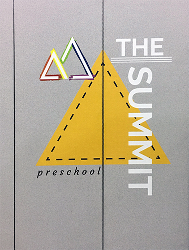 A close up of The Summit preschool logo printed on a divider