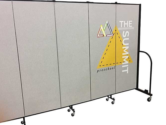 Grey room divider featuring The summit preschool logo