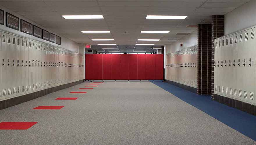 Red divider blocks entrance to a school hallway