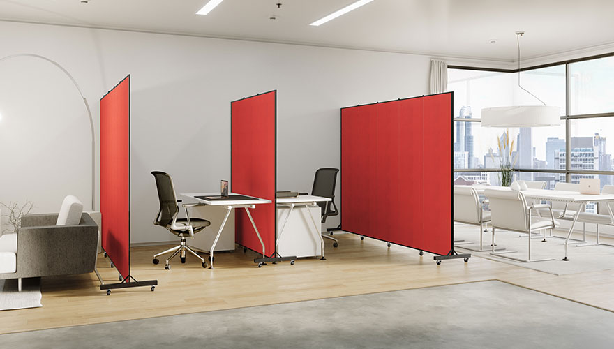 A trio of red room dividers separate workstations