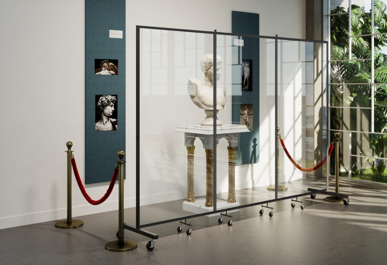 clear barrier in front of museum artifacts