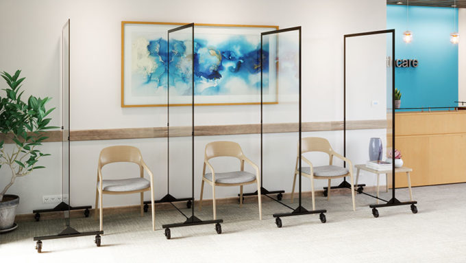 three chairs separated by clear dividers in waiting room