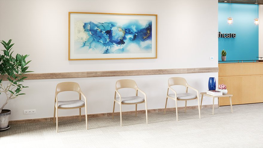 doctors office waiting room with three tan chairs