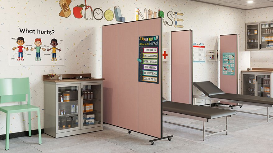 school nurse station with two empty beds and pink room dividers between them