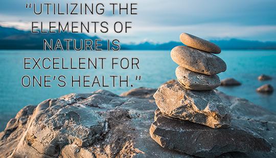 optimal healing environments-rocks stacked on a waterfront