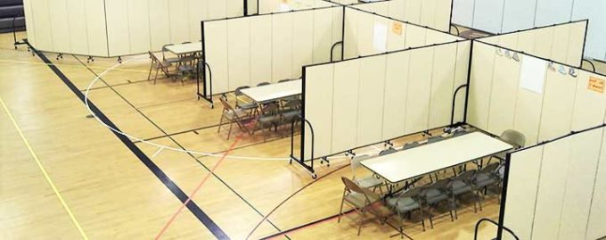 safety dividers-social distancing barriers surrounding workspaces in a gym