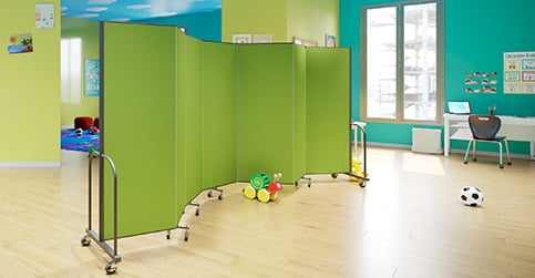 home daycare ideas- green divider separating the play space