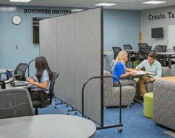 social distancing dividers separating a classroom