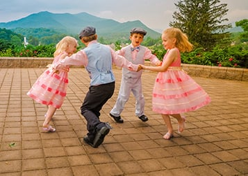 Pediatric kids dancing on an outdoor terrace