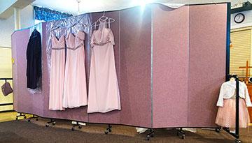 church wedding dresses hanging on a divider