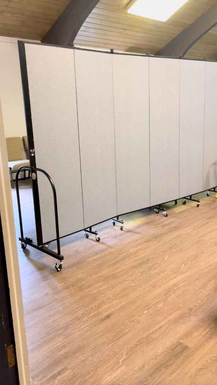 Room divider bordering kids' ministry space