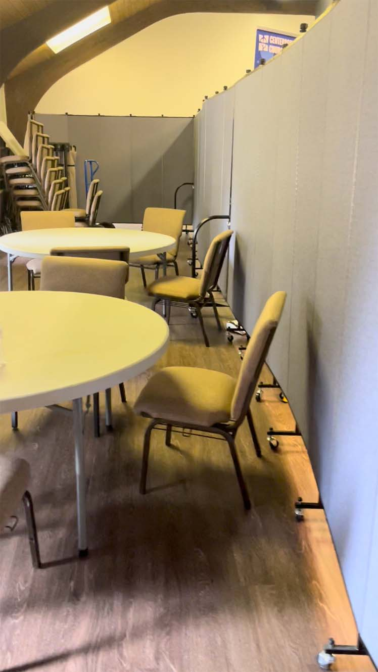 Room divider surrounding tables and chairs