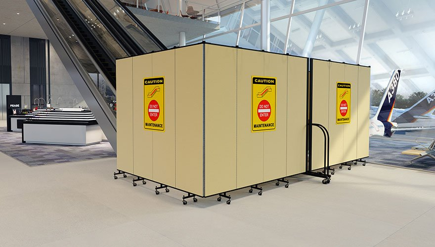 airport escalator closed for maintenance with portable barrier