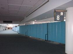 Portable Screenflex Partitions dividing an Airport Terminal